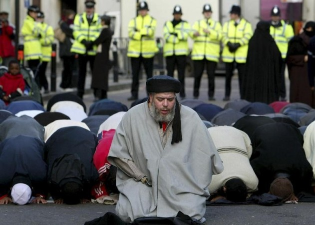Muslim cleric, Abu Hamza al-Masri, is seen leading prayers outside the North London Central Mosque, in Finsbury Park, north London in this January 24, 2003 file photograph.