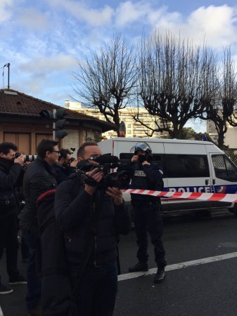 French police blocks the roads near a kosher grocery store as a terrorist militant holds several hostages in the store, in Porte de Vincennes, eastern Paris, on Jan. 9, 2015. French President Francois Hollande confirmed Friday night four hostages were kil