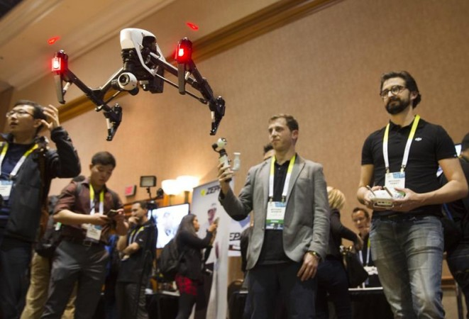 Michael Perry (R) flies a DJI Inspire 1 flying platform during the 2015 International Consumer Electronics Show