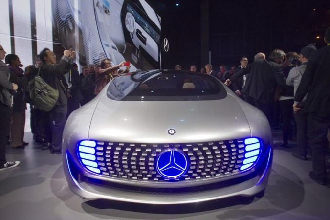 Journalist surround the Mercedes-Benz F015 Luxury in Motion autonomous concept car after it was unveiled during the 2015 International Consumer Electronics Show