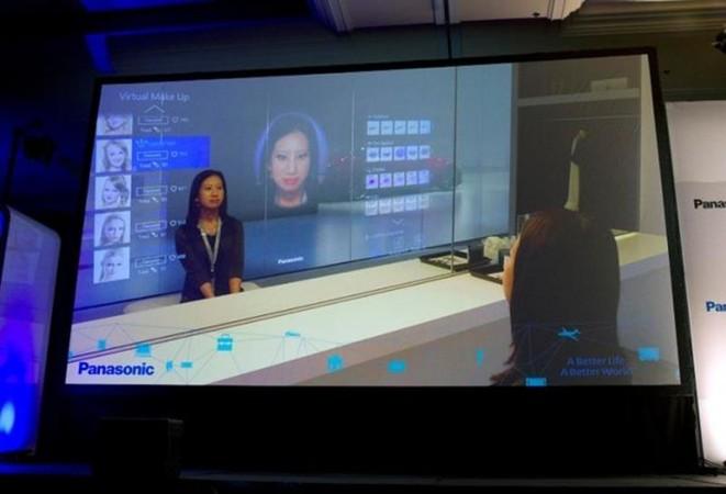 A display shows Panasonic's virtual make-up mirror at a Panasonic news conference during the 2015 International Consumer Electronics Show