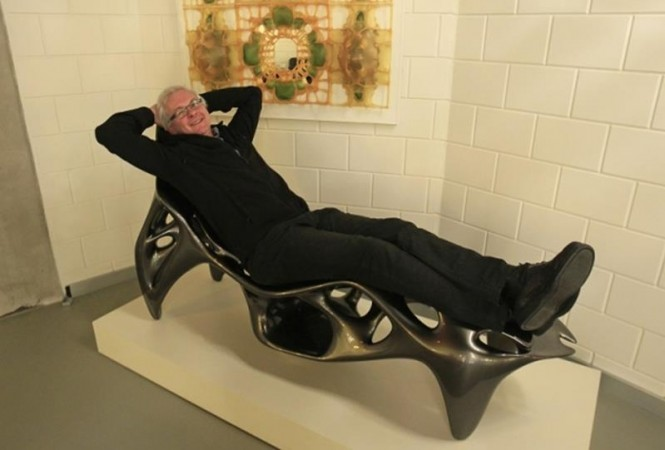 Wilfried Vancraen, chief executive of Belgian company Materialise, the biggest 3D printer in Europe, poses for Reuters on a 3D KOL/MAC Root Chair by Sulan Kolatan and William MacDonald, built in one piece on Materialise's Mammoth Stereolithography Machine