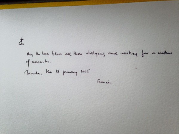 Pope Francis write in UST guest book