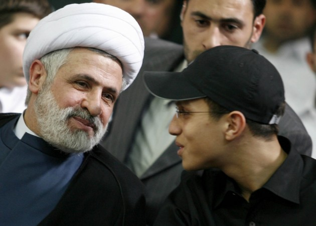 Jihad Moughniyah (R), son of Lebanon's Hezbollah late military leader Imad Moughniyah, sits beside Hizbollah Deputy Secretary General Naeem Kassem during a ceremony marking his fathers 40th death in Beirut's suburbs in this March 24, 2008 file photo.