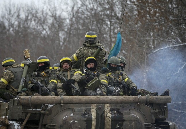 Members of the Ukrainian armed forces ride on an armoured personnel carrier (APC) near Debaltseve, eastern Ukraine, February 10, 2015.