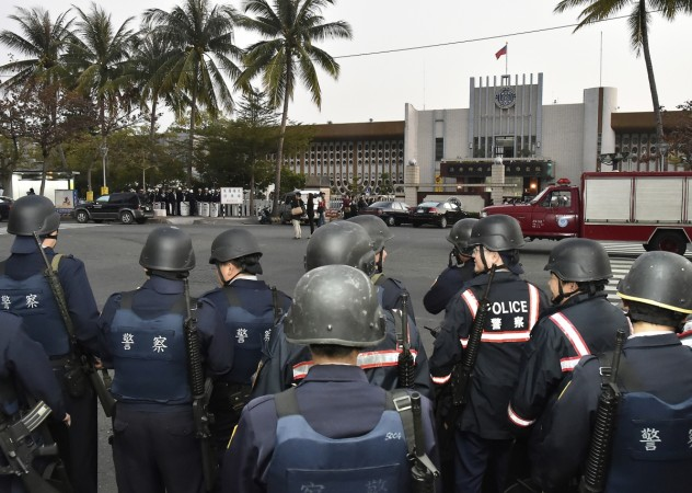 Police officers stand guard outside Kaohsiung Prison, southern Taiwan, February 11, 2015.