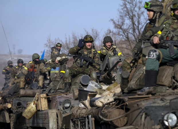 Members of the Ukrainian armed forces ride on armoured personnel carriers (APC) near Debaltseve, eastern Ukraine, February 12, 2015.