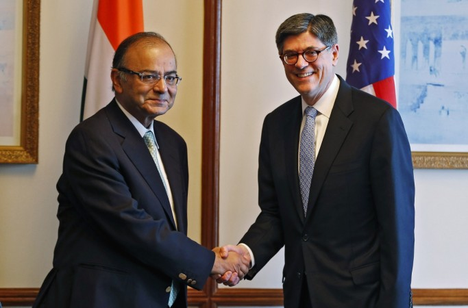 U.S. Treasury Secretary Jack Lew (R) shakes hands with India's Finance Minister Arun Jaitley