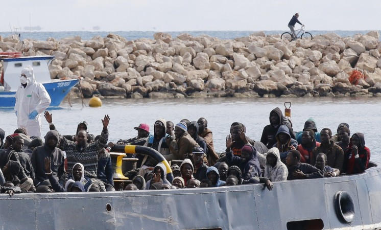 Migrants arrive by boat at the Sicilian harbour of Pozzallo, February 15, 2015