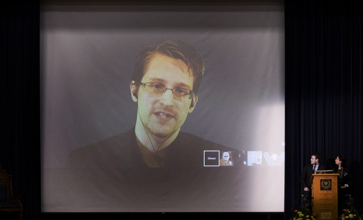 Former U.S. National Security Agency contractor Edward Snowden appears live via video with journalist Glenn Greenwald during a student organized world affairs conference at the Upper Canada College private high school in Toronto, February 2, 2015.