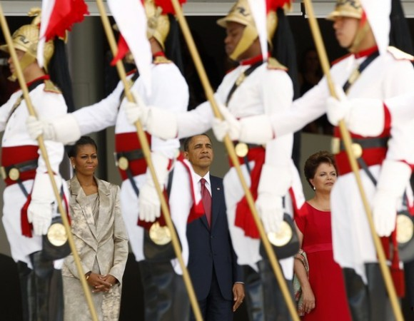The Obamas & Brazilian President Dilma Vana Rousseff observe the Brazilian honor guard during an arrival ceremony in Brasilia