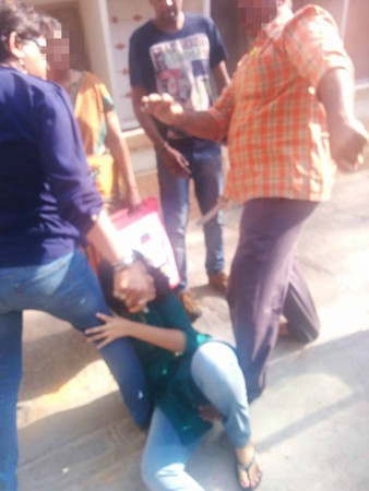 Cop thrashes daughter in public.