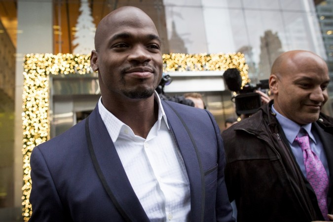Minnesota Vikings' Adrian Peterson exits following his hearing against the NFL over his punishment