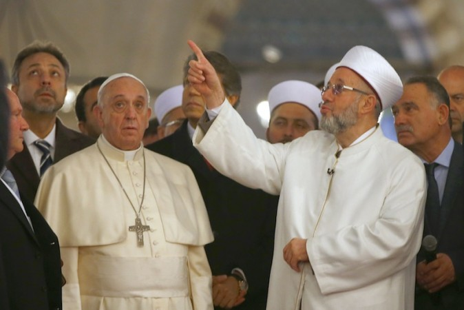 Pope Francis listens to Rahmi Yaran, Mufti of Istanbul (right) during a visit to Hagia Sophia in Istanbul