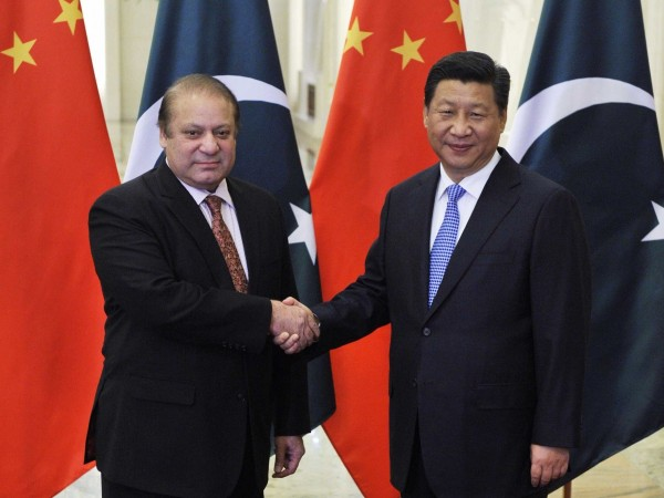Pakistan's Prime Minister Nawaz Sharif shakes hands with China's President Xi Jinping