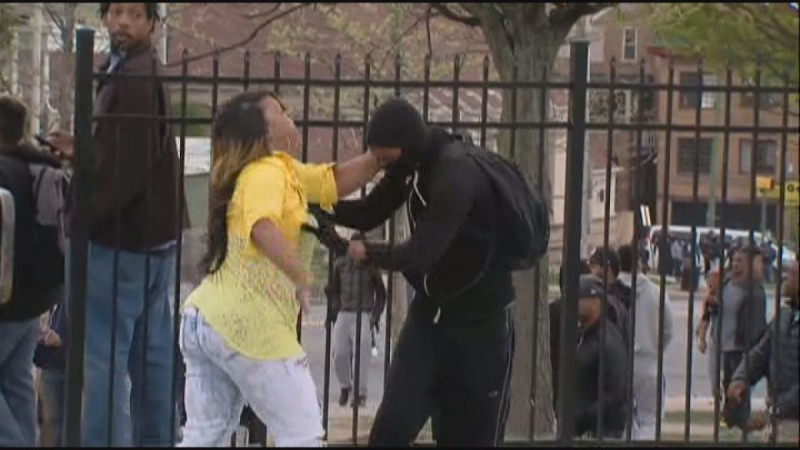 Baltimore mother hailed 'mother of the year' after she catches masked son rioting after Freddie Gray funeral.