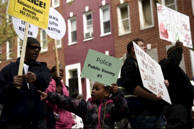 Demonstrators gather in front of Baltimore Police Department Western District in Baltimore, Maryland, April 25, 2015