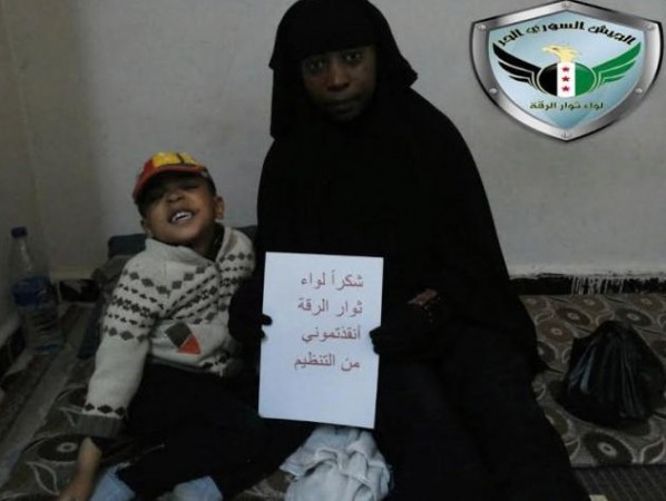 Syrian rebels hoodwinked Isis and helped a French woman escape along with her son. The woman identified as Nikolai holds a Thank You note as she poses with her son after escaping from Raqqa.