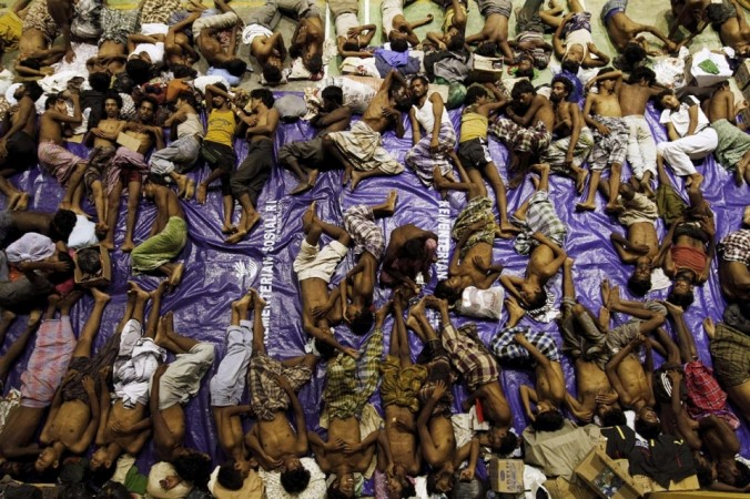 Rescued Rohingya migrants rest inside a shelter at Lhoksukon in Aceh Province, May 11, 2015