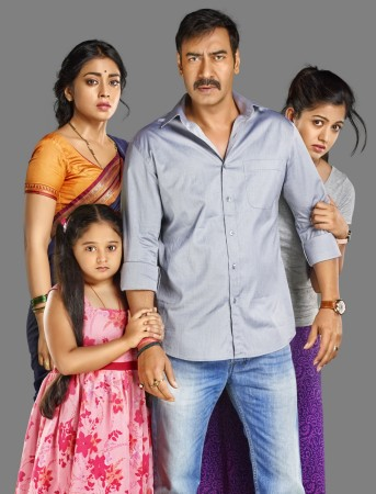 Ajay Devgn and Shriya Saran in 'Drishyam'