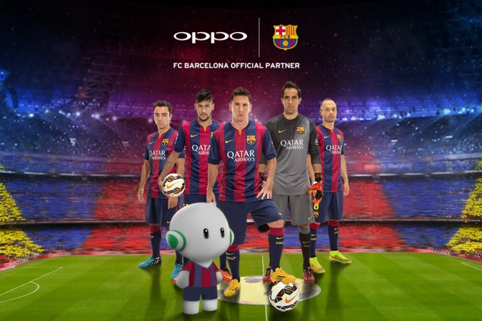 The Players of the First Team of FC Barcelona pose with the Oppo Mobile Mascot
