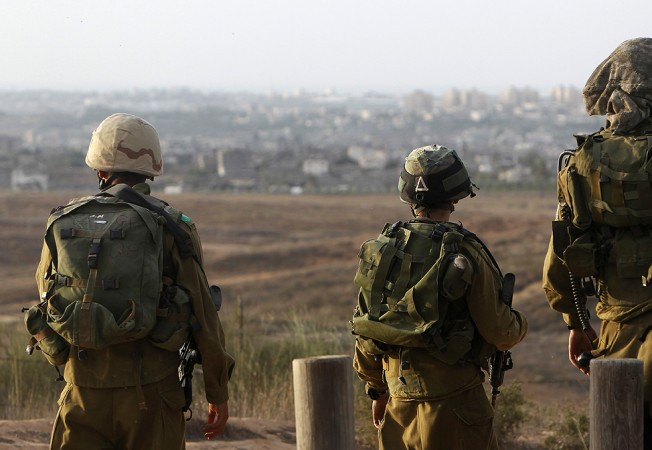 Israeli soldiers patrol near the border with the Gaza Strip.