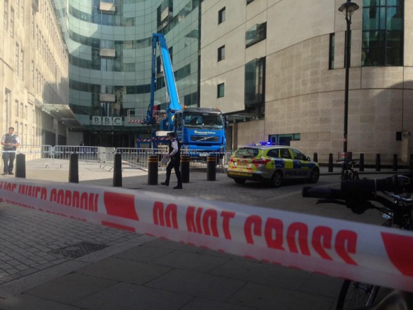 Police have arrested a man after he threatened to burn BBC's London office