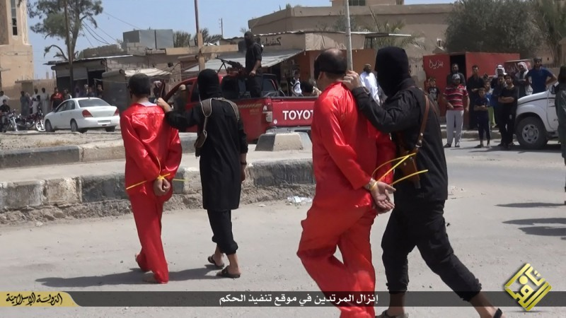 A file image shows Isis fighters taking Iraqi men condemned to be killed on charges of spying for the government.