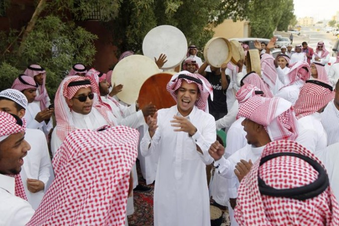 Saudi youth dance as they celebrate Eid al-Fitr in Riyadh in 2012