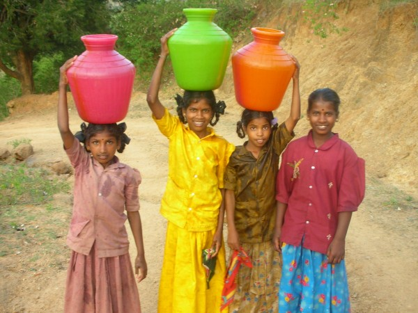 girls carrying water