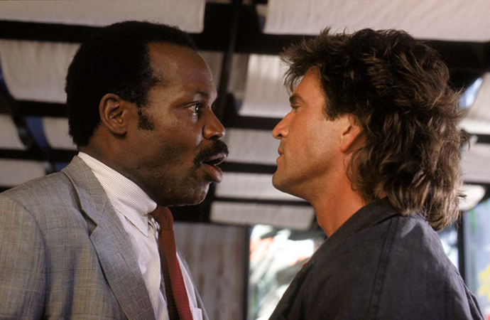 Danny Glover and Mel Gibson as Roger Murtaugh and Martin Riggs