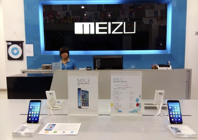 A shop assistant waits for customers at a Meizu store