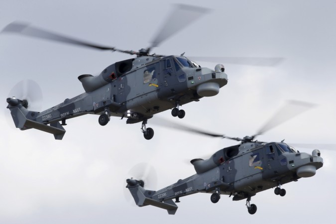 AgustaWestland Wildcat HMA.2 helicopters of the Black Cats Helicopter Display Team, of the British Royal Navy Fleet Air Arm, take part in a display during the Malta International Airshow at Malta International Airport, outside Valletta, Malta, September 2