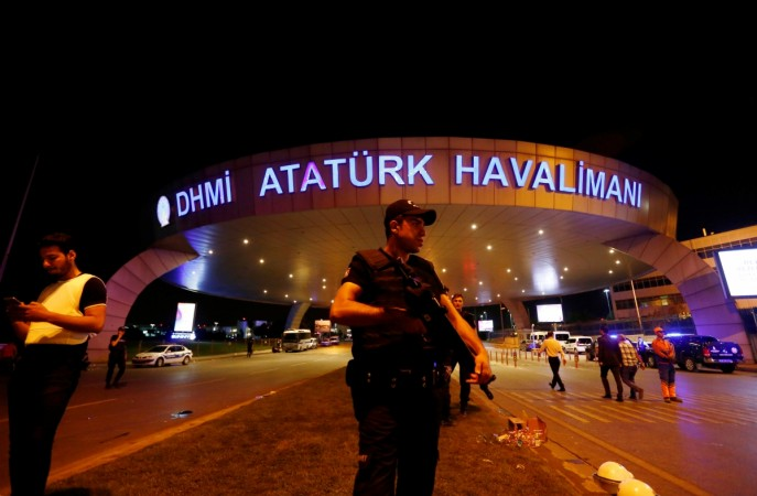 A riot police officer stands guard at the entrance of the Ataturk airport in Istanbul, Turkey, following a multiple suicide bombing, early June 29, 2016.