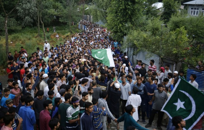 People attend funeral procession of militant Burhan Wani at his village in Tral of Jammu and Kashmir`s Pulwama district on July 9, 2016.