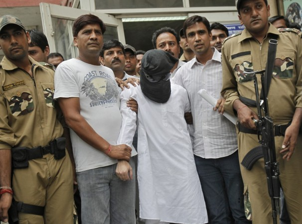 Sayeed Zabiuddin Ansari, with his face covered, leaves from a hospital in New Delhi June 29, 2012.