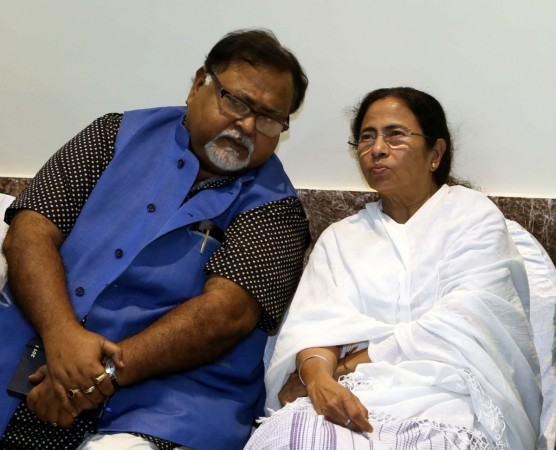West Bengal Chief Minister Mamata Banerjee and West Bengal Minister Partha Chatterjee during a Trinamool Congress meeting in Kolkata on Dec 12, 2015