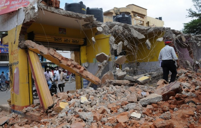 bbmp demolition drive officials bengaluru bangalore it city silicon valley india infosys intel wipro encroachment land developers sobha prestige adarsh section 288d constitution right to property