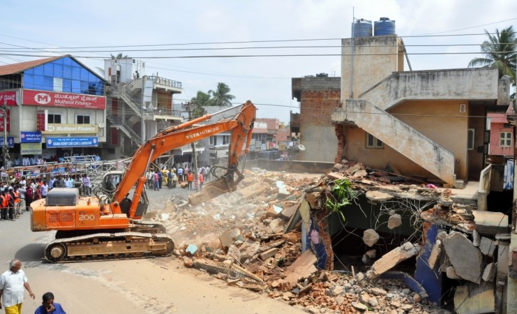 bbmp demolition drive officials bengaluru bangalore it city silicon valley india infosys intel wipro encroachment land developers sobha prestige adarsh panic residents