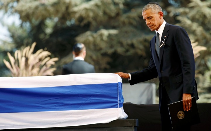 U.S President Barack Obama walks past the flag-draped coffin of former Israeli President Shimon Peres, after eulogising him at his funeral ceremony