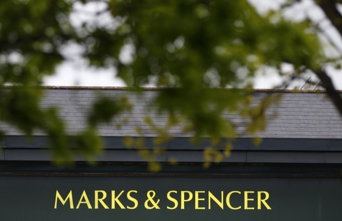 marks & spencer shuts shop uk stores overseas profit revenues retailer shopping clothes other products accessories perfume cosmetics garments food clothing
