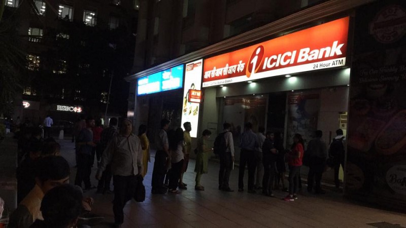 Money mayhem: People lining up outside ATMs to withdraw