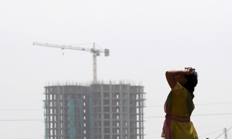 demonetisation construction real estate developer companies outlook fitch ratings sobha prestige puravankara dlf godrej india sensex grade