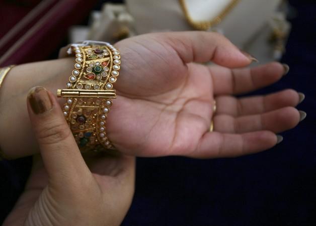 titan q3 results, titan share price, tanishq jewellery, tbz share price, pc jeweller share price, sensex, nifty