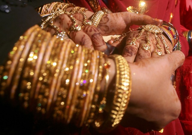 indian marriages, indian grooms and brides, marriages in india, axis bank merger, axis bank shikha sharma, axis bank share price, kotak mahindra bank