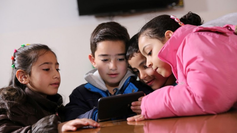 Image result for kids playing an app
