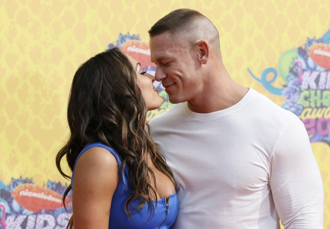 Model and wrestler Nikki Bella and WWE wrestler John Cena arrive at the 27th Annual Kids' Choice Awards