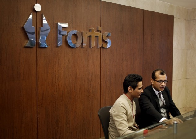 fortis healthcare, fortis stake malaysia ihh healthcare, fortis share price, fortis healthcare q4 results, fortis hospitals, fortis bulk deal