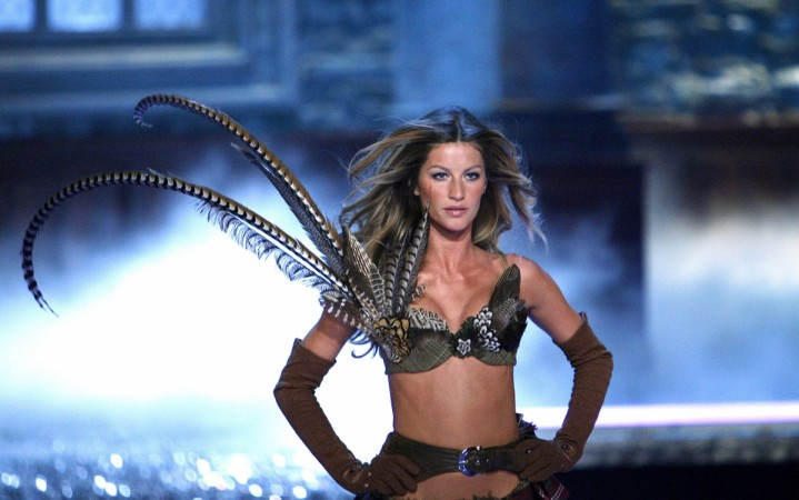 f49128480f Gisele Bundchen dances on the beach in a barely-there two-piece ...