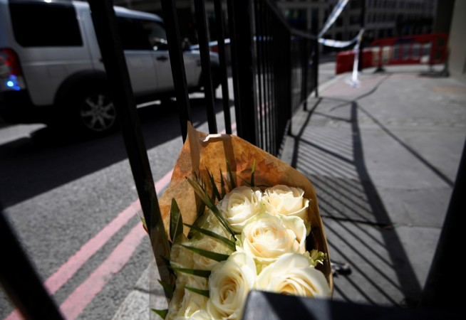 A bunch of flowers is left near London Bridge after an attack left 7 people dead and dozens injured in London